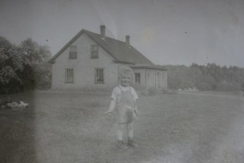 Showing child with house in background