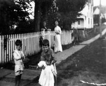 Street scene with house in background, c. 1905; Donna Collings Collection