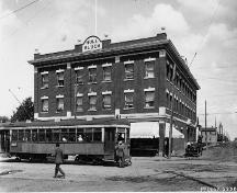 This historical image, dating from 1916, illustrates the front, west-facing primary facade of the building on 97th Street, an important arterial road connecting the McCauley neighbourhood with the downtown as evidenced by the streetcar line.; Glenbow Archives; McDermit Studio; NC-6-2382