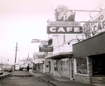 Historic view of Goodmanson Building and Round Up Cafe neon sign, circa 1950; City of Surrey, 2007