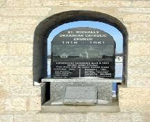 Detail view of the plaque, of the Bell Tower of the Ukrainian Catholic Church of St. Michael the Archangel, Tyndall, 2005; Historic Resources Branch, Manitoba Culture, Heritage, Tourism and Sport, 2005