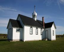 View, from the southwest, of the main elevations of the Ukrainian Catholic Church of the Blessed Virgin Mary, Malonton area, 2004.; Historic Resources Branch, Manitoba Culture, Heritage, Tourism and Sport, 2005