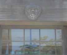 Featured is the Socrates mask over the front door of the Elsie Perrin Williams Memorial Library.; Kendra Green, 2007.