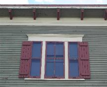 This photograph shows one of three triple set windows and the roof-line cornice ornamented with modillions, 2005; City of Saint John
