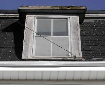 This image provides a view of a dormer above the projected cornice, 2005 ; City of Saint John