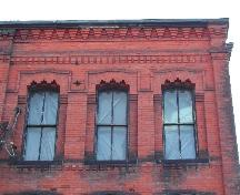 This photograph shows the roof-line and the detailed openings, 2005; City of Saint John