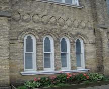 Featured are the four narrow double-hung windows, including common sill and gothic surround.; Kayla Jonas, 2007.