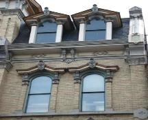 Featured are the decorative dormer windows and the cornice supported by brackets.; Martina Braunstein, 2007.
