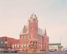 Corner view of the Humboldt Post Office, showing two prominent facades joined by a large four-storey clock tower.; Parks Canada Agency / Agence Parcs Canada.