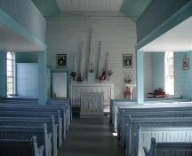 View of interior nave looking towards altar of Saint Margaret of Scotland Catholic Church, River Denys Mountain, Nova Scotia, 2002.; Inverness County Heritage Advisory Committe, 2002