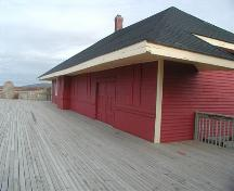 South west corner of the Inverness Railway Station showing the front elevation, Inverness Railway Station, Inverness, Nova Scotia, 2002. ; Inverness County Heritage Advisory Committe, 2002.