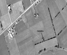 Aerial view shows cemetery located amid trees; Province of PEI, 1974