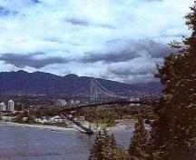 View of the Lions Gate Bridge, showing one of its twin, tapered open work towers that consist of sections of flat and angled steel, 2003.; Parks Canada Agency / Agence Parcs Canada, Judith Dufresne, 2003.