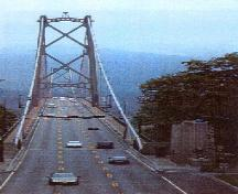 View of the Lions Gate Bridge, showing its Art Deco architectural elements and fittings that form the south entrance to the bridge, 2003.; Parks Canada Agency / Agence Parcs Canada, Judith Dufresne, 2003.