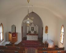 View of altar and raised pulpit from rear loft.; Government of Saskatchewan, Lisa Dale-Burnett, 2004.