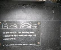 Plaque located on bulkhead, on main facade. Photo taken 2008.; HFNL 2008