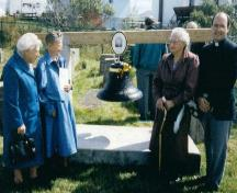 Photo after a ceremony of re-dedication at First Anglican Cemetery, Arnold's Cove, NL, showing the bell erected in memory of Jonathan Boutcher, 1990; Courtesy of Iris Brett, 2008
