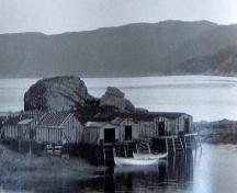 Historic photo showing fisheries premises around The Quidnock, Conche, NL, circa 1970s.; Courtesy C. Cochrane, 2008