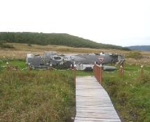Photo of 1942 Plane Crash Municipal Heritage Site, showing plan wreck, Conche, NL, 2004; Courtesy of French Shore Historical Society, 2008