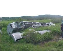 Photo showing plane wreck at the 1942 Plane Crash Site, Conche, NL, 2003; Courtesy of French Shore Historical Society, 2008