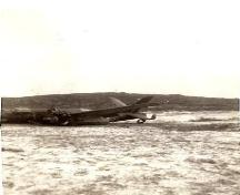 Photo showing the plane at the 1942 Plane Crash Site, Conche, NL in 1942.; Courtesy of French Shore Historical Society, 2008