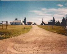View of the main entrance to the Lac Ste. Anne Pilgrimage National Historic Site of Canada, 1994.; Parks Canada Agency / Agence Parcs Canada, 1994.