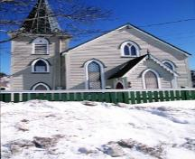 View of the façade of Christ Church / Quidi Vidi Church, showing its Gothic Revival style, including its square side tower, capped by a spire, 1994.; Parks Canada Agency / Agence Parcs Canada, J. Butterill, 1994.