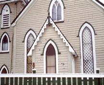 View of the storm porch of Christ Church / Quidi Vidi Church, showing the three-bay façade with central door flanked by pointed arch windows under drip mouldings, 1994.; Parks Canada Agency / Agence Parcs Canada, J. Butterill, 1994.
