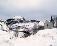 View of Christ Church / Quidi Vidi Church, showing its location on a steep hill overlooking the harbour, 1994.; Parks Canada Agency / Agence Parcs Canada, J. Butterill, 1994.