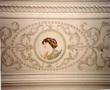 Interior view of Castle Kilbride, showing an early 20th-century arabesque painted within a real plaster border, 1993.; Parks Canada Agency / Agence Parcs Canada, J. Hucker, 1993.