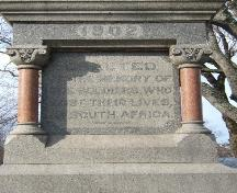 "This photograph shows one of four sides of the base of the statue, inscribed ""Erected to the memory of the soldiers who lost their lives, in South Africa"", 2006 ; City of Saint John"