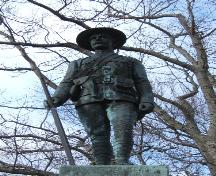 This photograph shows a statue of a Boer War soldier in a resting position with his rifle, 2006; City of Saint John
