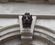 One of three lion heads located in the keystones of the arched windows on the main facade, 214 Duckworth Street. Photo taken June 13, 2007.; Deborah O'Rielly HFNL 2007