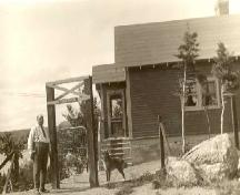 Photo of Captain Olaf Olsen and house, showing a portion of the front facade with side porch at Fjordheim, Holyrood, circa 1940; Courtesy Brendan Hunt, Tea Garden Restaurant, 2008