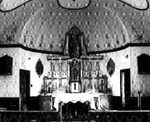 Interior view of Ste. Anne's Roman Catholic Church, showing the domed semi-circular sanctuary, 1991.; Parks Canada Agency / Agence Parcs Canada, 1991.