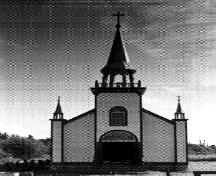 General view of Ste. Anne's Roman Catholic Church, showing the corner towers with projecting spires on the front façade, 1991.; Hay River Dene Band / Bande des Dénés de Hay River, 1991.