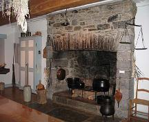 Interior view of Maison Saint-Gabriel, showing one of the large, stone fireplaces, 2005.; Parks Canada Agency / Agence Parcs Canada, N. Clerk, 2005.