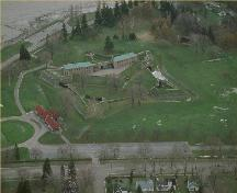 Aerial view of Fort Erie, showing its setting on a flat grassed parcel of land overlooking Lake Erie at the mouth of the Niagara River, 1991.; Parks Canada Agency / Agence Parcs Canada, 1991.