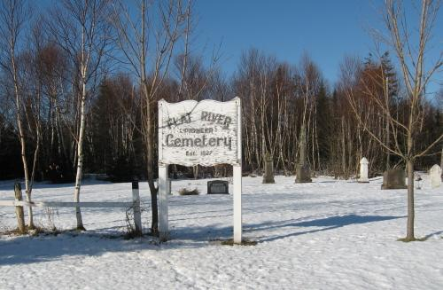 Overview of cemetery with sign