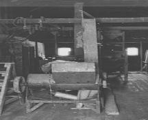 General view of seed cleaning machinery at Seager Wheeler's Maple Grove Farm, 1994.; Parks Canada Agency / Agence Parcs Canada, E. Mills, 1994.
