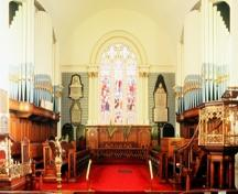 Interior view of St. Paul's Anglican Church, showing the altar and the simple, plastered interior finish, 1994.; Parks Canada Agency / Agence Parcs Canada, 1994.