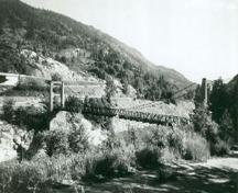 General view of the Doukhobor Suspension Bridge, 1994.; Agence Parcs Canada/Parks Canada Agency,  1994.