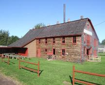 Side elevation including opening for log carriage, Sutherland Steam Mill Museum, Denmark, NS, August, 2008.; Dept. of Tourism, Culture and Heritage, Province of Nova Scotia, 2008