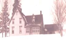 Showing east elevation; Archival image of house in winter