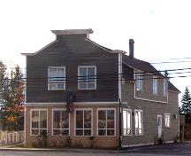 This image shows the boomtown style front façade of the building, 2007; Town of Shippagan