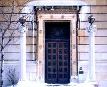 Detail view of the Masonic Memorial Temple, showing the main entrance with its bronze door and surrounding motifs, 2000.; Parks Canada Agency / Agence Parcs Canada, A. Waldron, 2000.