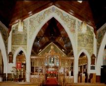 General view of St. Jude's Anglican Church, showing the decorative designs of the chancel.; Parks Canada Agency/ Agence Parcs Canada.