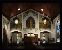 General view of St. Jude's Anglican Church, showing a series of painted murals around the nave presenting events in the life of Jesus Christ.; Parks Canada Agency/ Agence Parcs Canada.