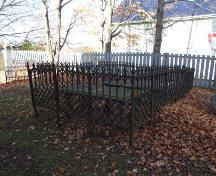 Gravemarkers enclosed by cast iron fence, Covenanter Church, Grand Pré, Nova Scotia, 2006. ; Heritage Division, NS Dept. of Tourism, Culture and Heritage, 2006