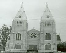 View of Saint Paul's Roman Catholic Church, showing its twin 26-metre-high ornate spires projecting from the front elevation.; Parks Canada Agency / Agence Parcs Canada.